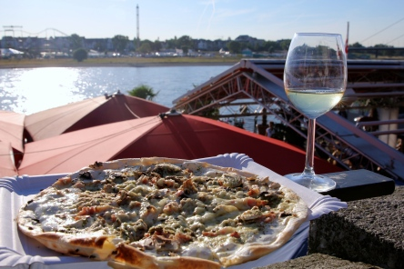 Delicious flatbread pizza with a glass of French wine.